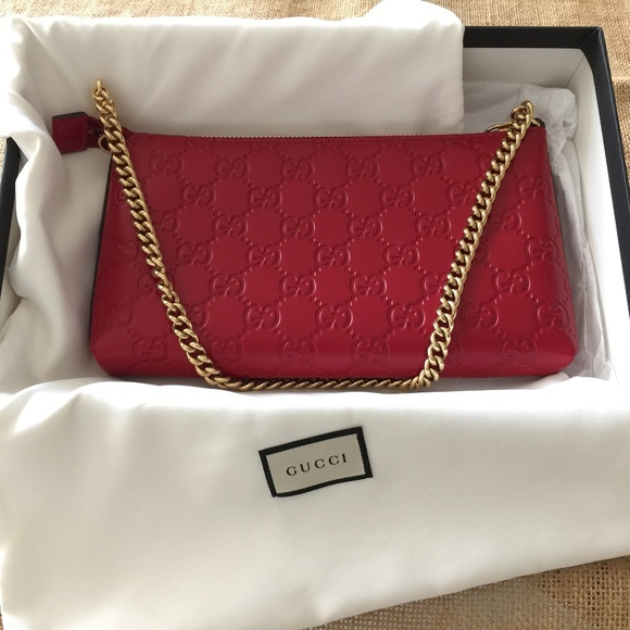 55205a9f Red Gucci clutch with Gold Chain
